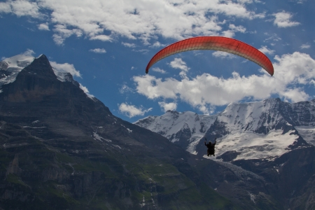 tectonics: This paraglider soars through the Swiss Alps  Stock Photo