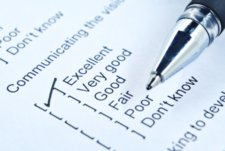 verry: Communication survey form and pen tick in box Stock Photo