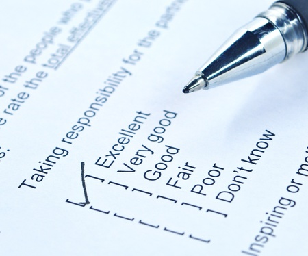 Pen tick on responsibility quality survey form Stock Photo - 12246639
