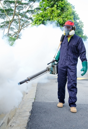 disease control: Environmental health workers are fogging to control dengue Stock Photo