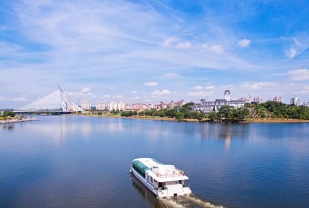Tour boat sails on the Putrajaya Lake photo