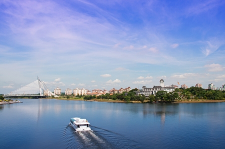 Tour boat sails on the Putrajaya Lake Stock Photo