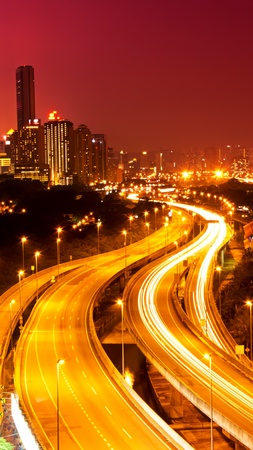 Kuala Lumpur city with stunning light trail from the busy highway traffic  photo