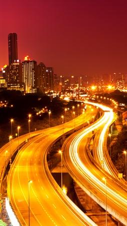 kuala lumpur tower: Kuala Lumpur city with stunning light trail from the busy highway traffic