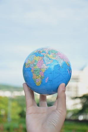 Globe on hand photo