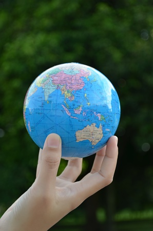 Globe on hand with green Stock Photo - 13594315