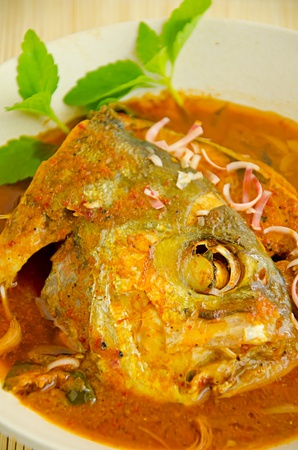 Fish dish - called Asam Pedas  It is the famous dish among malaysian  photo