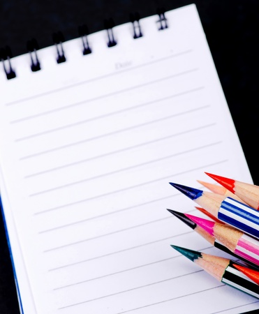 notebook paper background: Pencils color and memo book