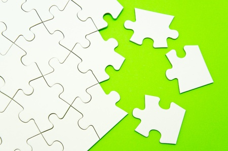 puzzle background: Jigsaw puzzle on green background
