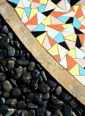 Black Stone and scattered colorful tile background  photo