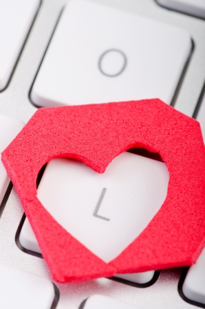 single story: Heart shape love symbol on keyboard Stock Photo