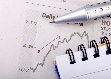 Analyzing the business graph and pointing Stock Photo - 16109760