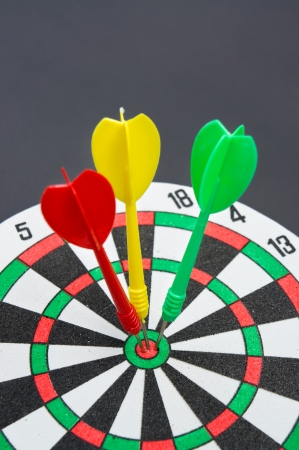 bull     s eye: Three darts hitting target