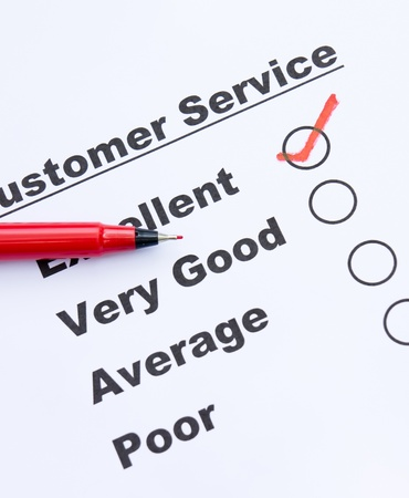 respondent: Customer service survey form and pen tick in box