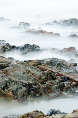Sea stone and waves in slow shutter photo