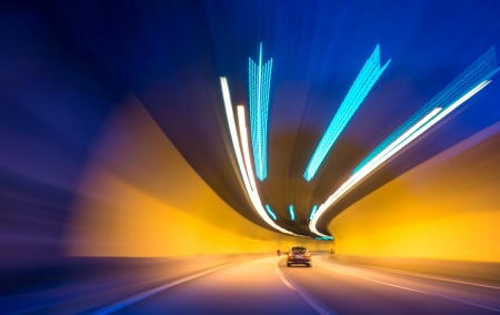 Car moving into tunnel -Abstract View  photo