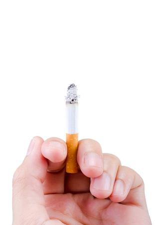 hombre fumando: Manejo de cigarrillo aislado Foto de archivo