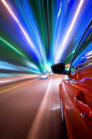 Night driving in city-motion blur building light Stock Photo