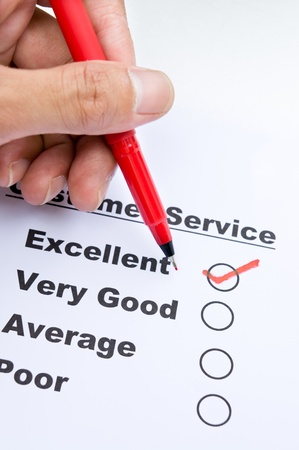 Customer service survey form and pen tick in box  Stock Photo - 18981027