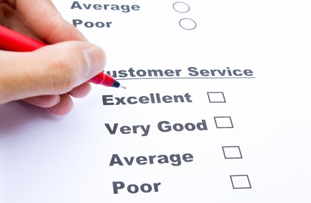 Customer service survey form and pen tick in box Stock Photo - 18981023
