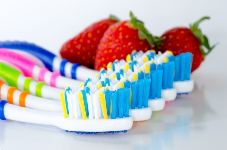 Close up toothbrush and strawberry isolated Stock Photo - 21400856