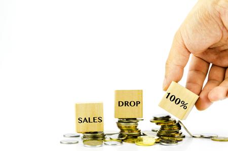 ingresos: Financial drop concept - Stack of coins and 100% written Foto de archivo