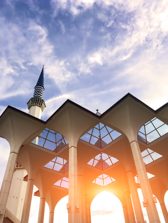 minarets: Minarets of Sultan Salahuddin Abdul Aziz Mosque, Shah Alam, Selangor, Malaysia - Evening sunlight through the mosque Stock Photo