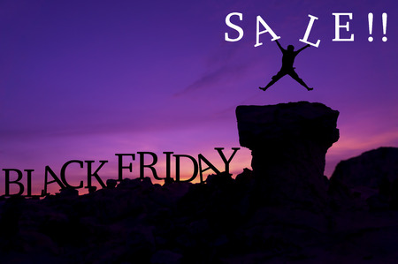 mount price: Silhouette man jumping on stone and holding word Sale - Black Friday sales concept