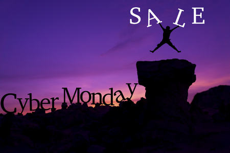 mount price: Silhouette man jumping on stone and holding word Sale - Cyber Monday sales concept