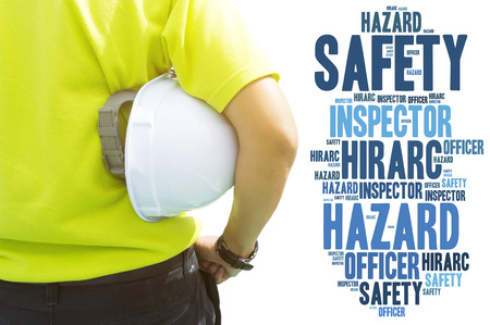 risks: Safety and Health in workplace concept - Engineering man or Safety Inspector standing with safety word collage concept Stock Photo