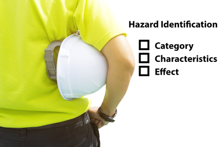 risks: Hazard Identification and Risk Assessment concept (Safety work place) - Engineering man or Safety Inspector standing with hazard identification checklist.
