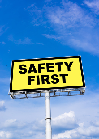 billboard background: Safety First sign billboard and clouds blue sky background