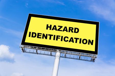 billboard background: Hazard Identification sign billboard and clouds blue sky background