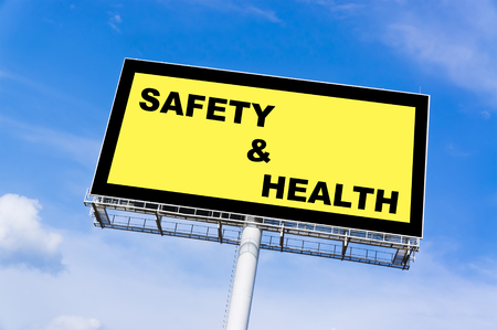 billboard background: Safety and health sign billboard and clouds blue sky background Stock Photo