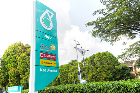 oil and gas: PUTRAJAYA, MALAYSIA - January 14, 2017 : PETRONAS logo at the Petrol Station PETRONAS at Putrajaya on January 14, 2017. Petronas is a Malaysian oil and gas company that was founded on 17 August 1974 Editorial