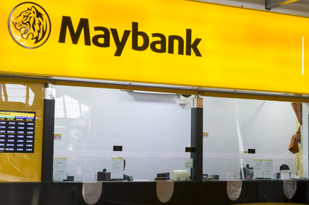 bank branch: SEPANG, MALAYSIA - JANUARY 14, 2017: MAYBANK Counter at Kuala Lumpur International Airport. Maybank is the largest bank and financial group with 401 domestic branches in Malaysia.