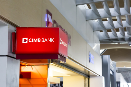 SEPANG, MALAYSIA - JANUARY 14, 2017: CIMB Islamic bank signboard at Kuala Lumpur International Airport. CIMB Group is a universal back headquartered in Kuala Lumpur. Editorial