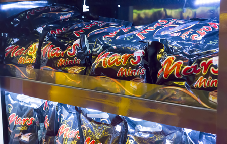mars incorporated: SEPANG,MALAYSIA - JANUARY 14,2017: Mars chocolate on shelves at marketplace Kuala Lumpur International Airport. Mars bars are produced by Mars Incorporated.