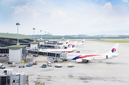 mas: SEPANG,MALAYSIA - JANUARY 14,2017 : Malaysia Airlines planes prepare for passengers to board, as ground crew prepares the plane for the flight at KLIA, Sepang, Malaysia.