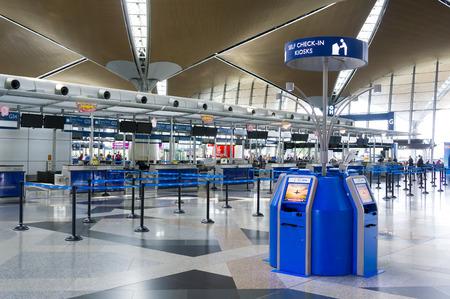 airport check in counter: SEPANG,MALAYSIA-JANUARY 14, 2107: Self check in counter signboard at Kuala Lumpur International Airport. Editorial