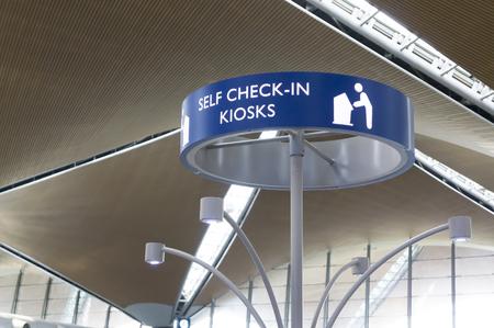 check in: SEPANG,MALAYSIA-JANUARY 14, 2107: Self check in counter signboard at Kuala Lumpur International Airport. Editorial