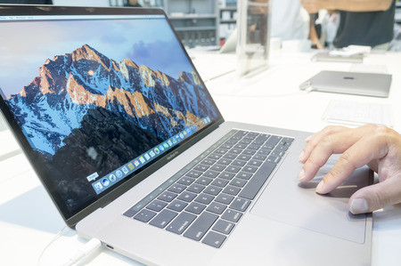 macbook pro: KUALA LUMPUR, MALAYSIA-JANUARY 15,2017: Unidentified man using new Apple Macbook Pro computer at shopping mall Kuala Lumpur. 2017 Macbook Pro comes with USBC port. Editorial