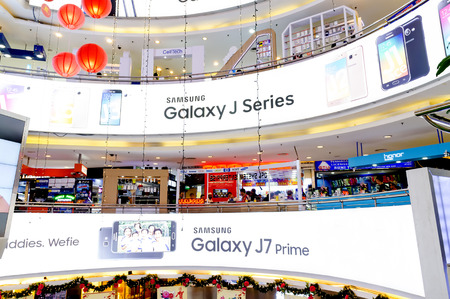 yat: KUALA LUMPUR, MALAYSIA - JAN 15, 2017 : Interior view of Low Yat Plaza Kuala Lumpur, Malaysia. Low Yat Plaza is a modern hi-tech shopping mall specializing in electronic products