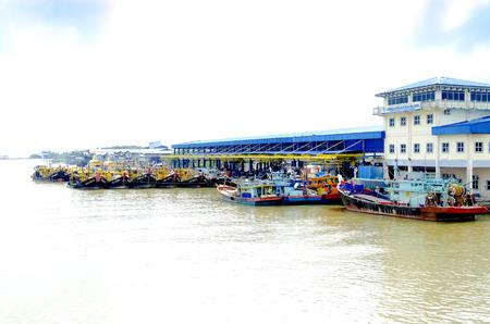 JOHOR, MALAYSIA - JANUARY 30, 2017: Fishing boats anchored at the jetty during the monsoon season at Endau, Johor, Malaysia. Endau is one of the most important fisheries in Johor.