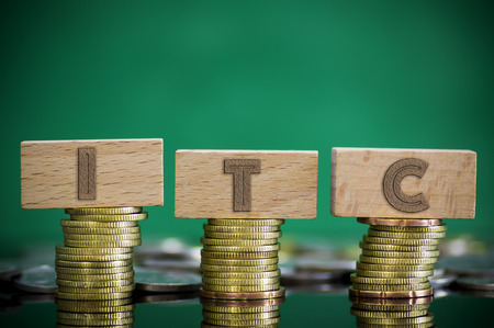 Finance Concept with Stack of Coins - ITC (International Trade Commission) written on
