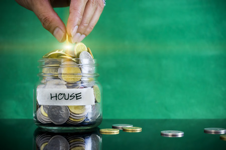 personel: Preparation for future and financial concept. Coins in glass jar with HOUSE label. Malaysia coins.