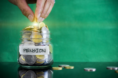personel: Preparation for future and financial concept. Coins in glass jar with PENSION label. Malaysia coins. Stock Photo