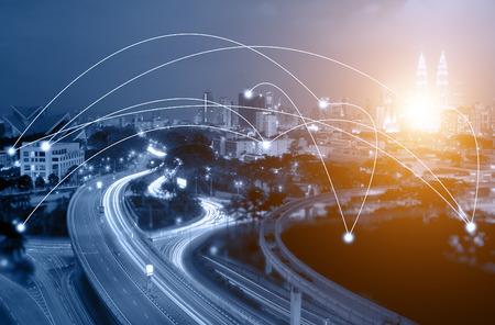 Blue tone Kuala Lumpur cityscape and network connection concept. Sunbeam effect. Sunbeam effect. Stock Photo