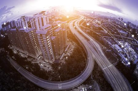 Blue tone Kuala Lumpur cityscape and network connection concept. Fisheye lens effect. Sunbeam effect.