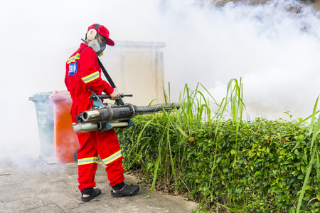 albopictus: PUTRAJAYA, MALAYSIA - JULY 29, 2017 : Unidentified pest control operator from Ministry Of Helath Malaysia fogging to eliminate mosquito for preventing spread dengue fever and zika virus.